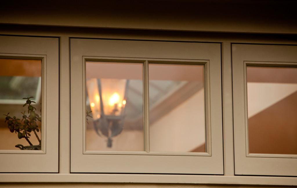 Narrow casement windows with a single bar dividing each casement