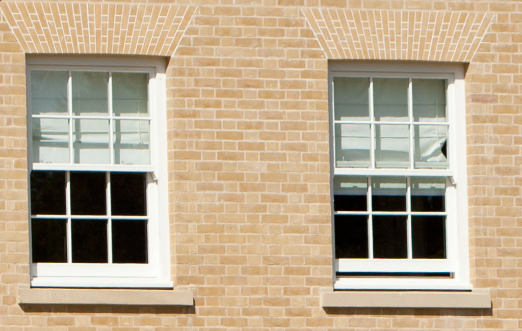 A pair of sliding sash windows in perfect harmony with property