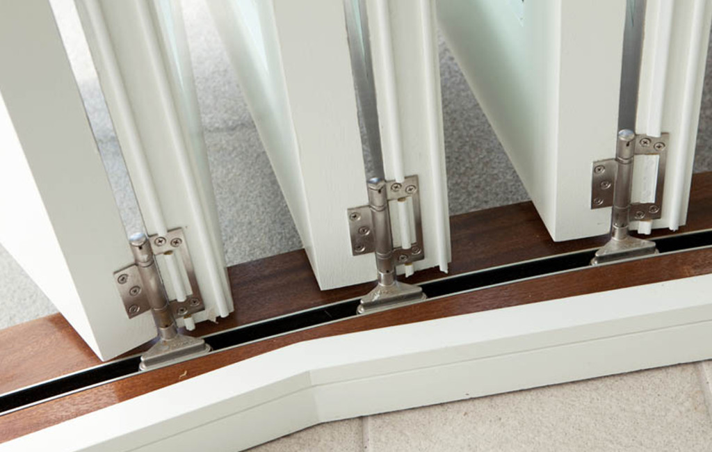 Detail image of hinges and track to a folding sliding door set